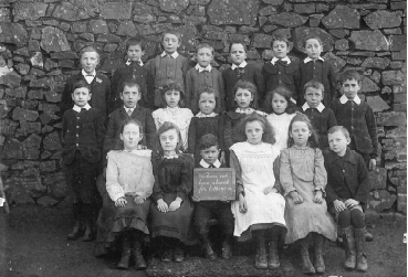 Perfect attendees at Rackenford School, 1905. Almost all the boys in the picture were to fight in WW1. Sam Roberts, second from left in the middle row, was killed as was David Fook, fourth in the top row.