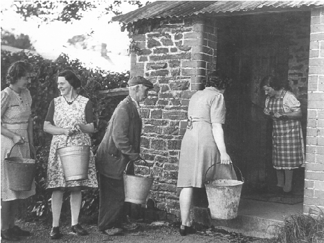 Fetching water from the wellhouse, 1950