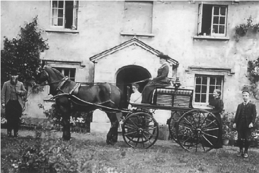 Miss Devon visting her gamekeeper at the Lodge, about 1904